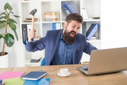Destroy laptop. Hateful job. Bad computer. Mad manager. Annoyed user. Slow internet connection. Outdated software. Computer lag. Lagging system. Hate office routine. Man bearded crush computer.