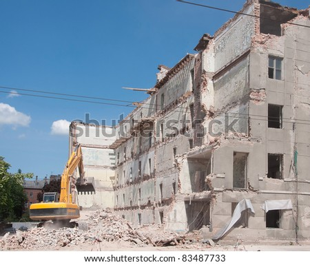 Destroyed building and bulldozer, demolition, earthquake, bomb, catastrophe, disaster.