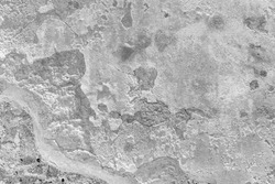 Destroyed chipped wall of farm house. Black white exterior urban facade. Whitewashed ruined structure background. Grunge uneven old stone rock texture. Outside crack crash cement mortar for 3d design