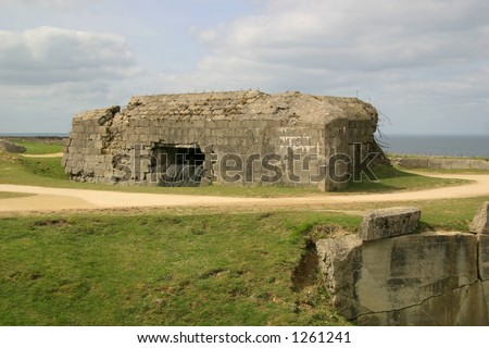 Destroyed German bunker at Pointe Du Hoc - attacked by Allied forces during the invasion of Normandy on D-Day during WW2.