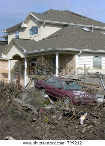 destroyed home and car about 100 ft. from the 17th Street Canal levee breach that flooded New Orleans after Hurricane Katrina