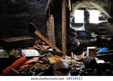 Destroyed old house interior . Mess and chaos.