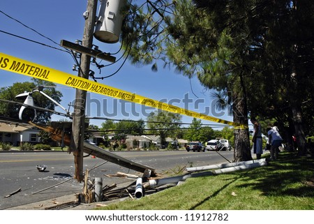 Destroyed power pole after an SUV crashed through it