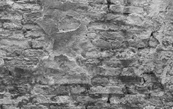 Destroyed shabby eroded dry ruined overlay pattern black white. Crumbly cement mortar texture. Chipped structure stone facade. Textured uneven urban brick wall outside. Grunge modern exterior for 3d