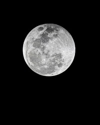 Detail and close up of full moon, is the lunar phase when the Moon appears fully illuminated from Earth's perspective. This occurs when Earth is located between the Sun and Moon, lunar hemisphere.