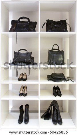 Detail bags and shoes in modern boutique - stock photo