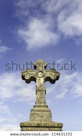 Detail close up of a Christian cross with sky background