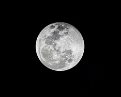 Detail close up of full moon, is the lunar phase when the Moon appears fully illuminated from Earth's perspective. This occurs when Earth is located between the Sun and Moon, lunar hemisphere.