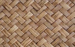 Detail close up view of a uniform golden woven basket using natural branch materials.