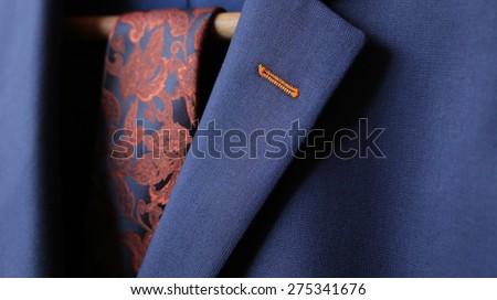 Detail closeup close-up of suit jacket lapel button hole fabric