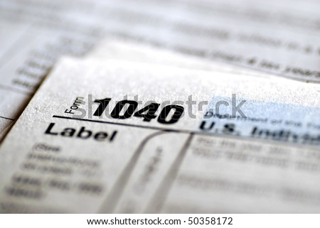 Detail closeup of current tax forms for IRS filing - stock photo