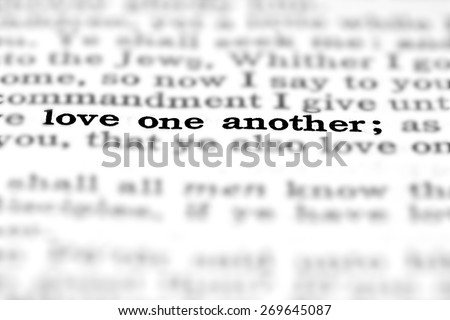 Detail closeup of New Testament Scripture quote Love One Another Stock foto ©