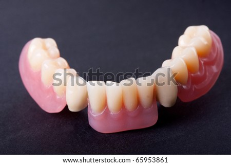 detail dental wax model ower black background - stock photo
