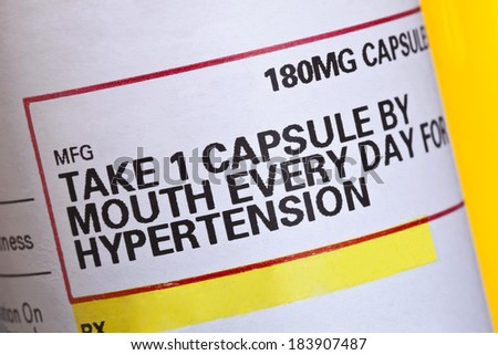 Detail from a label on a prescription medication for high blood pressure.