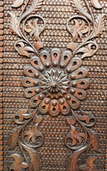 Detail from an old iron metal door. Close - up of ornament. Texture, background