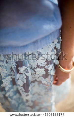 Detail from sky blue mohair sweater and 3D lace skirt