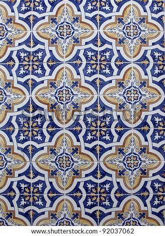 Detail from traditional tiles on facade of old house in Lisbon, Portugal