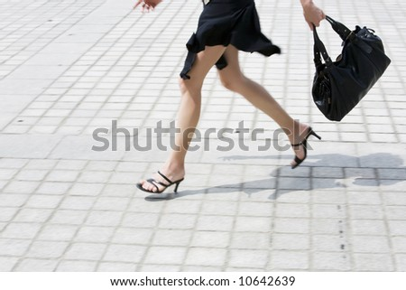 detail in blur of  woman legs running on the pavment