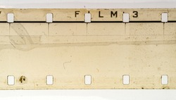 detail macro shot of blank exposed grungy 16mm filmstrip on white background