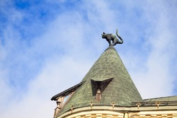 Detail monument of  black cat on top of yellow House is styled as medieval architecture with some elements of Art Nouveau, building in 1909 according to the blueprint of architect Friedrich Scheffelin