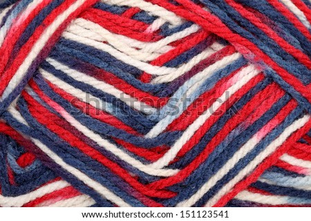 Detail of a ball of colorful yarn, texture background
