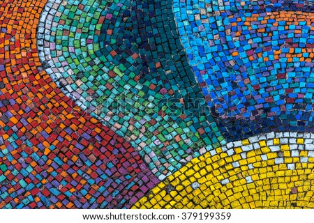 Detail of a beautiful old crumbling abstract ceramic mosaic decoration was destroyed building. Venetian mosaic as a decorative background. Selective focus #379199359