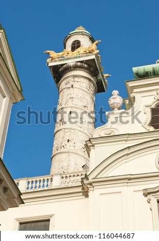 Detail of a beautiful ornamental column of Karlskirche, the Church of St. Charles - Vienna, Austria