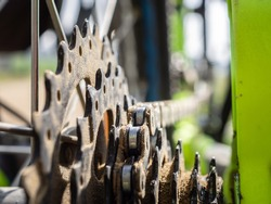 detail of a bicycle chain and sprocket with blurred background - bicycle parts