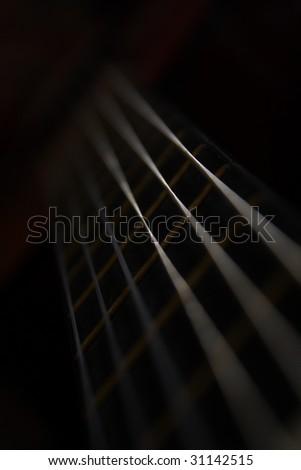Detail of a black acoustic guitar in black