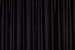 Detail of a black closed curtain in a theater