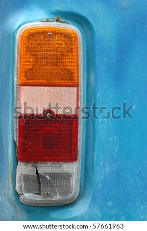 Detail of a Brake Light on a Weathered Vintage Camper Van