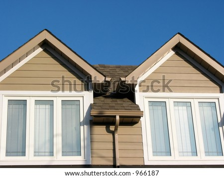 Detail of a brand new house on a bright blue sky background