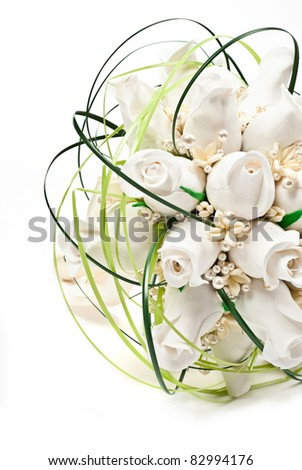 Detail of a bridal bouquet. On white background