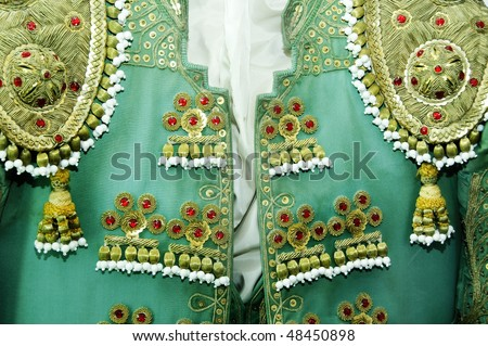 detail of a bullfighter dress, the costum of a torero - stock photo