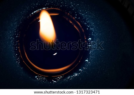 Detail of a burning blue candle, beautiful candle, scented candle #1317323471