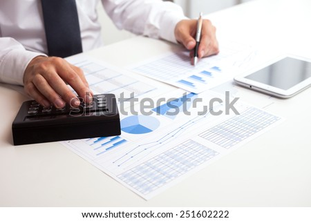 Detail of a business man at work in his office