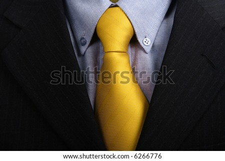 detail of a Business man Suit with yellow tie