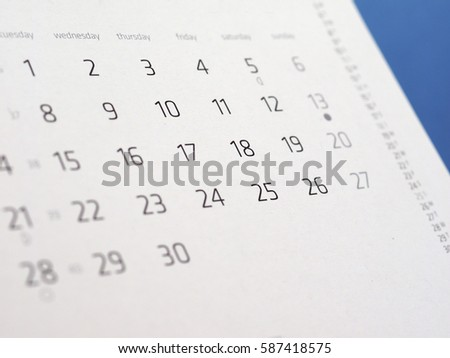 detail of a calendar page with dates #587418575
