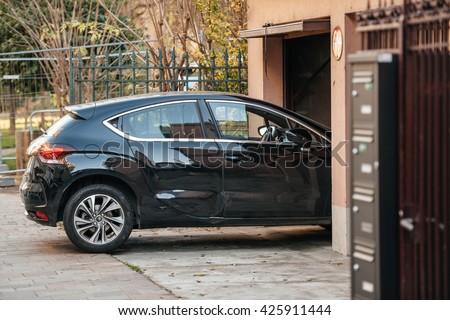 Detail of a car entering through garage door
