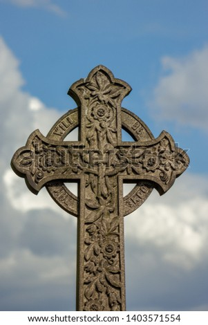 Detail of a Celtic Cross, a design that  dates from the Middle Ages but is still a popular symbol in burial grounds and cemeteries because of it's ornate carving and symbolism #1403571554