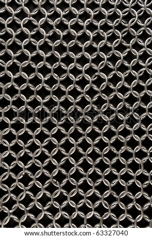 Detail of a chainmail on black #63327040