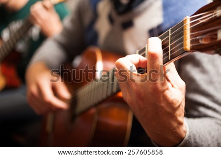 Detail of a classical guitar player