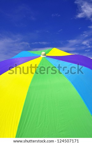 Detail of a colorful beach umbrella, useful as a background texture