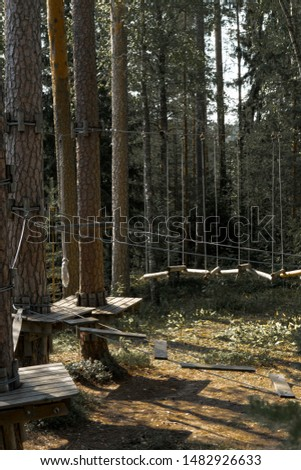 Detail of a constructions in adventure park. Wooden parts connected to each other by steel cable. Strong connections to stand active usage of the devices. Outdoor activity area. Aegviidu, Estonia #1482926633