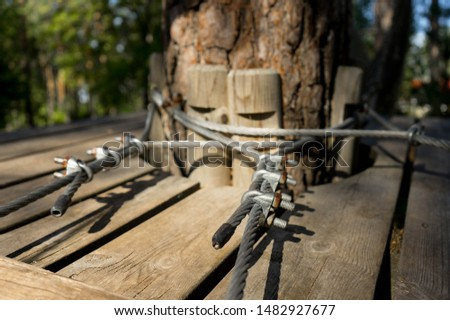Detail of a constructions in adventure park. Wooden parts connected to each other by steel cable. Strong connections to stand active usage of the outdoor sporting goods. Aegviidu, Estonia #1482927677
