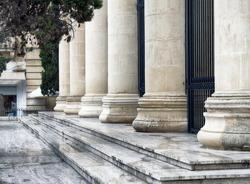 Detail of a court house. Roman columns architecture in Valletta, Malta