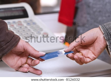 Detail of a credit card payment moment in a shop.