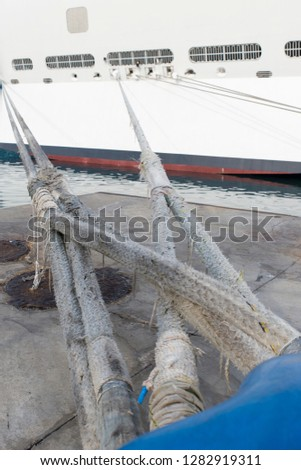 Detail of a cruise ship tied with a bowline to the dock