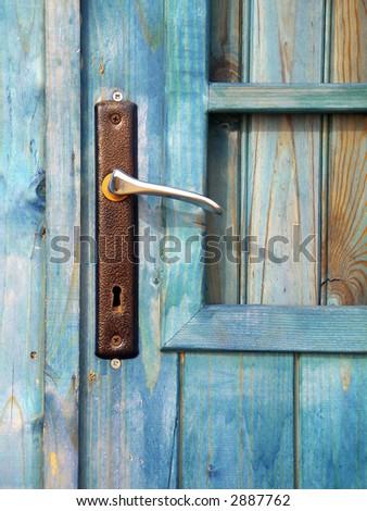Detail of a door handle in a old beach hut.
