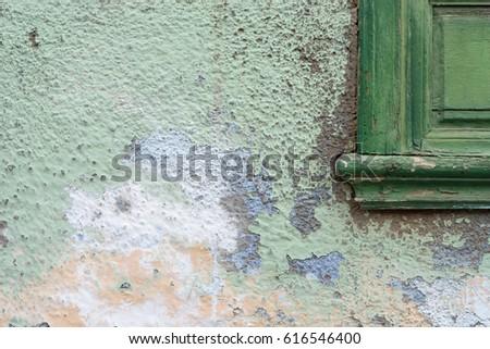 Detail of a facade / weathered facade / facade to be renovated #616546400